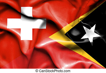 Waving flag of East Timor and Switzerland
