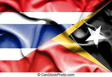 Waving flag of East Timor and Thailand