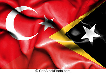 Waving flag of East Timor and Turkey