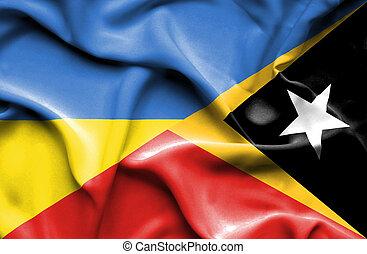 Waving flag of East Timor and Ukraine