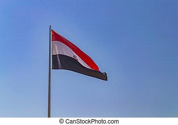 Waving flag of Egypt on blue sky