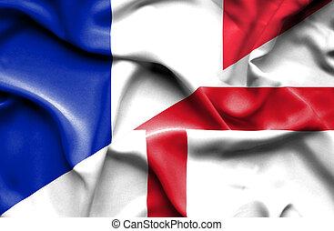 Waving flag of England and France