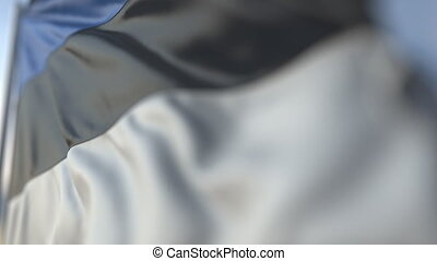 Waving flag of Estonia, shallow focus close-up. Realistic loopable 3D animation
