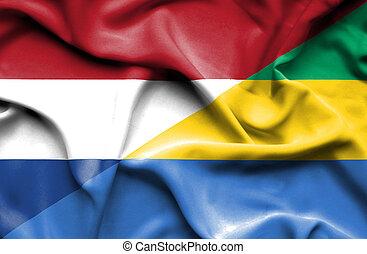 Waving flag of Gabon and Netherlands