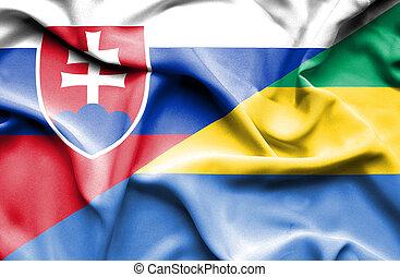 Waving flag of Gabon and Slovak