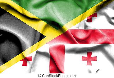 Waving flag of Georgia and Jamaica
