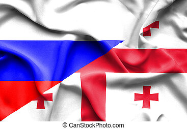 Waving flag of Georgia and Russia