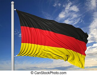 Waving flag of Germany on flagpole, on blue sky background.