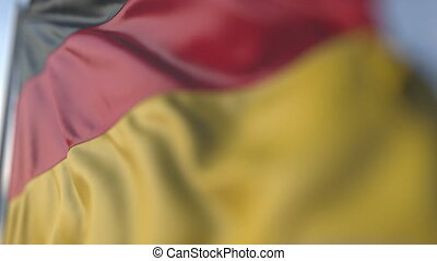 Waving flag of Germany, shallow focus close-up. Realistic loopable 3D animation