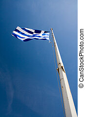Waving Flag of Greece on the blue sky background