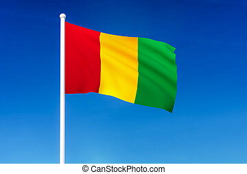 Waving flag of Guinea on the blue sky background