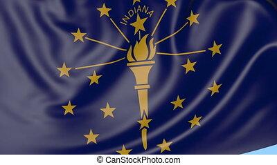 Waving flag of Indiana state against blue sky. Seamless loop