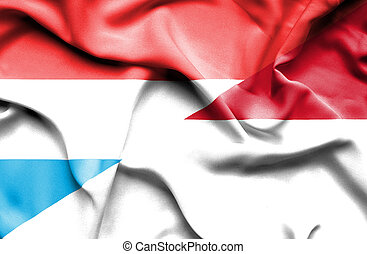 Waving flag of Indonesia and Luxembourg