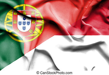 Waving flag of Indonesia and Portugal