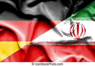 Waving flag of Iran and Germany