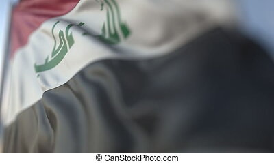 Waving flag of Iraq, shallow focus close-up. Realistic...