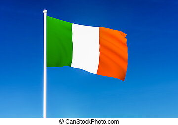 Waving flag of Ireland on the blue sky background