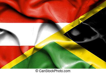 Waving flag of Jamaica and Austria