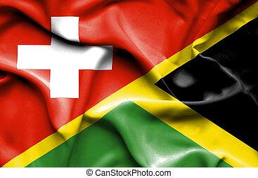 Waving flag of Jamaica and Switzerland