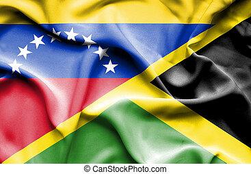 Waving flag of Jamaica and Venezuela