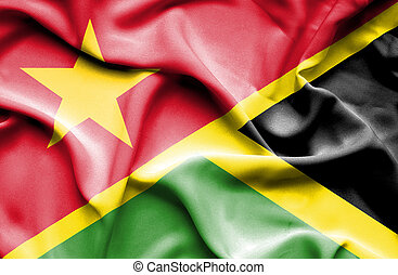 Waving flag of Jamaica and Vietnam