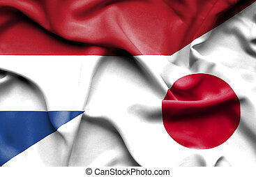 Waving flag of Japan and Netherlands