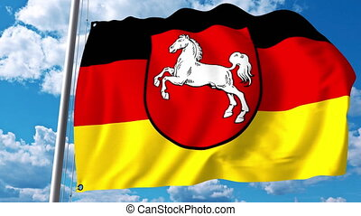 Waving flag of Lower Saxony a state of Germany