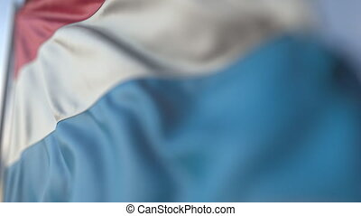 Waving flag of Luxembourg, shallow focus close-up. Realistic loopable 3D animation