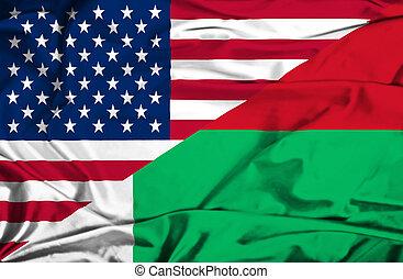 Waving flag of Madagascar and USA