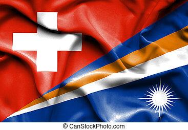 Waving flag of Marshall Islands and Switzerland