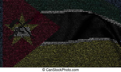 Waving flag of Mozambique made of text symbols on a computer...
