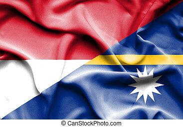 Waving flag of Nauru and Indonesia