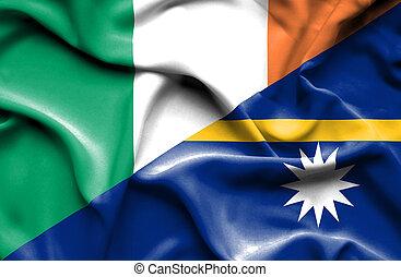 Waving flag of Nauru and Ireland