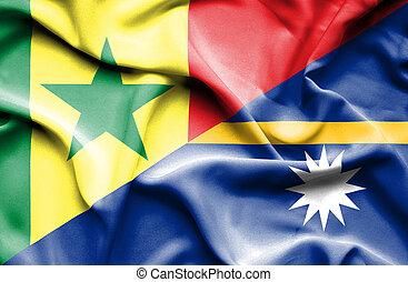 Waving flag of Nauru and Senegal