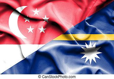 Waving flag of Nauru and Singapore