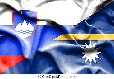 Waving flag of Nauru and Slovenia