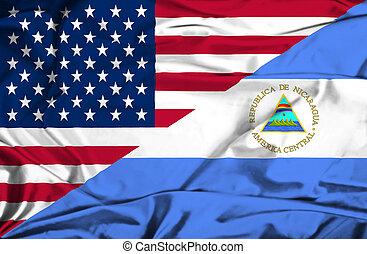Waving flag of Nicaragua and USA