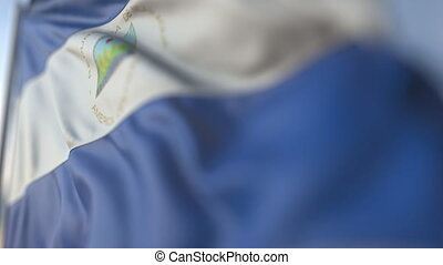 Waving flag of Nicaragua, shallow focus close-up. Realistic loopable 3D animation