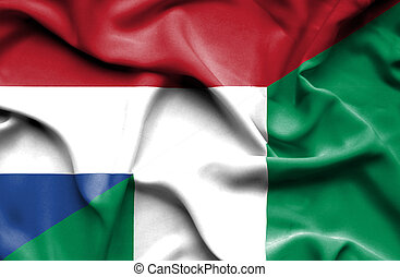 Waving flag of Nigeria and Netherlands