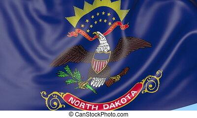 Waving flag of North Dakota state against blue sky. Seamless...