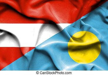 Waving flag of Palau and Austria