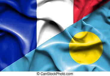 Waving flag of Palau and France