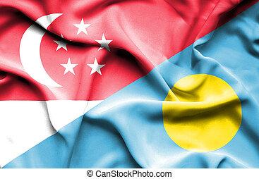 Waving flag of Palau and Singapore