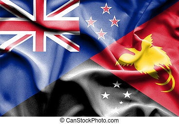 Waving flag of Papua New Guinea and New Zealand