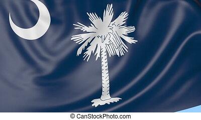 Waving flag of South Carolina state against blue sky.