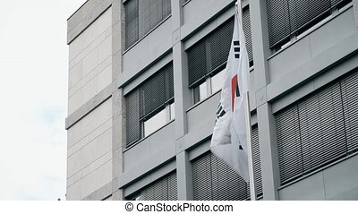 Waving flag of South Korea on the pole