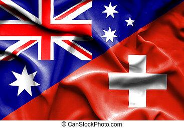 Waving flag of Switzerland and Australia
