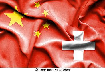 Waving flag of Switzerland and China