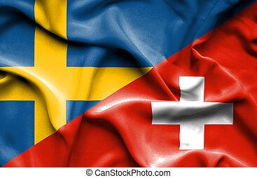 Waving flag of Switzerland and Sweden
