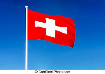 Waving flag of Switzerland on the blue sky background